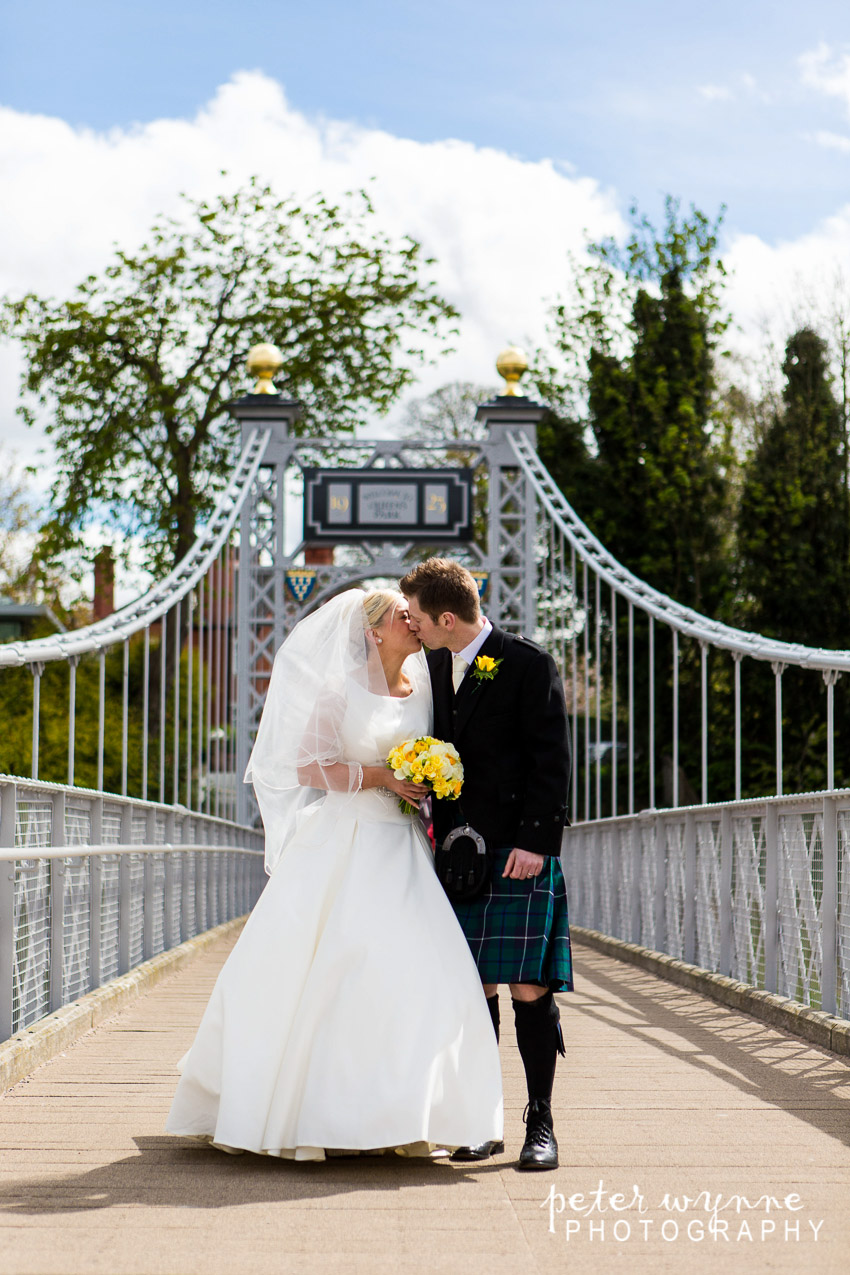 Bride and groom on Queens Park Bridge