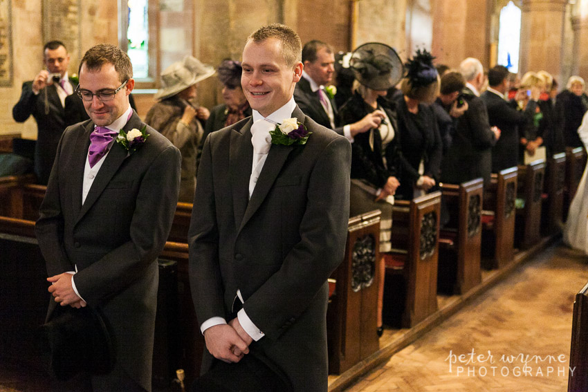 Groom waiting at ceremony