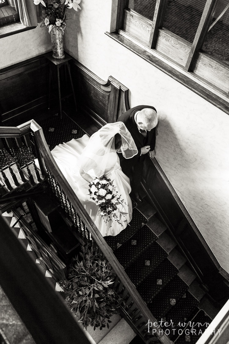 Bride and father on stairs