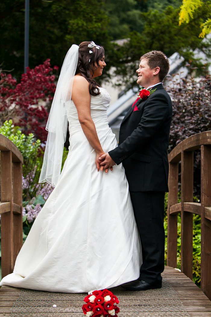 Bride and groom on bridge portrait