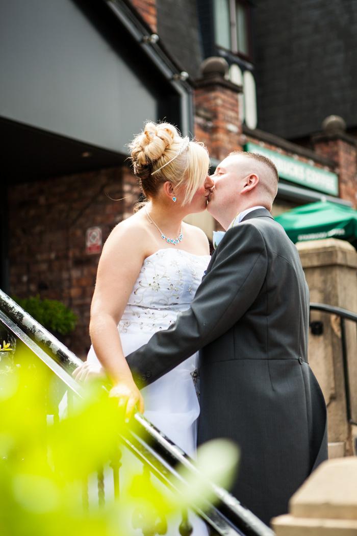 Bride & groom kissing portrait
