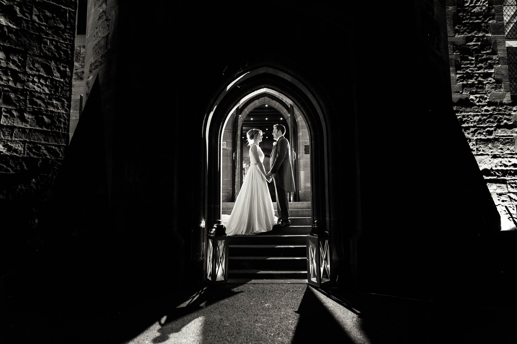 bridal portrait inside arch of Peckforton Castle