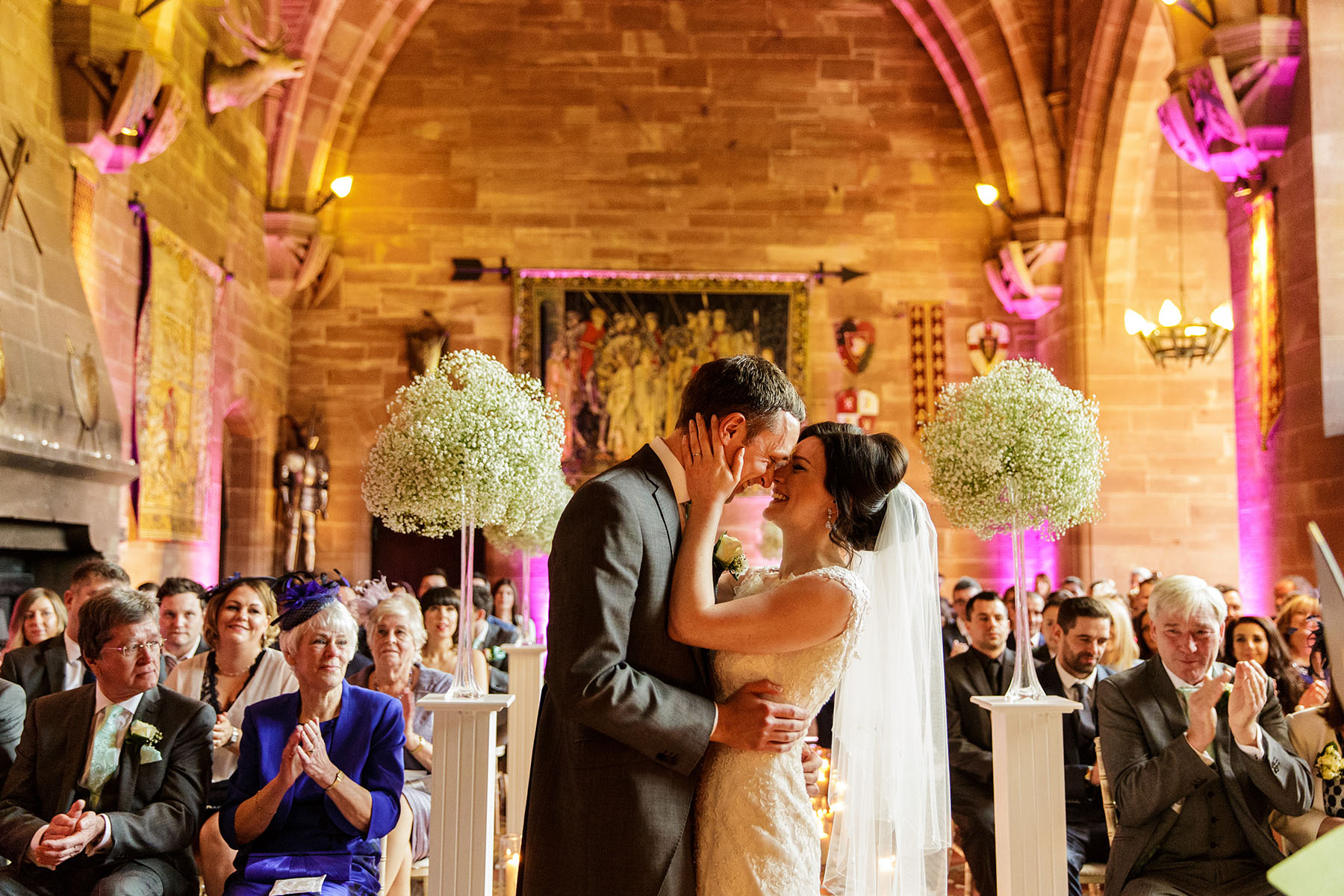 bride and groom embracing after Peckforton wedding ceremony