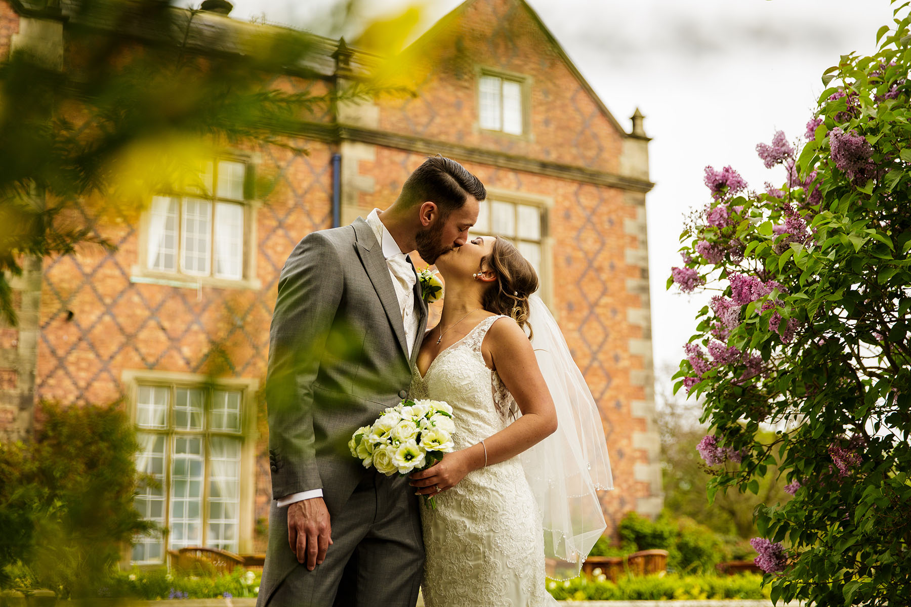 Willington Hall kissing bridal portrait