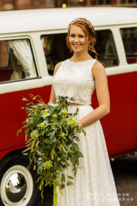 Bridal portrait in front of camper van at Wrenbury Hall