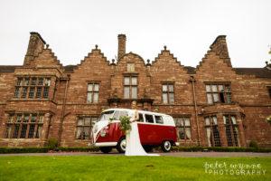 Bridal portrait in front of camper van at Wrenbury Hall