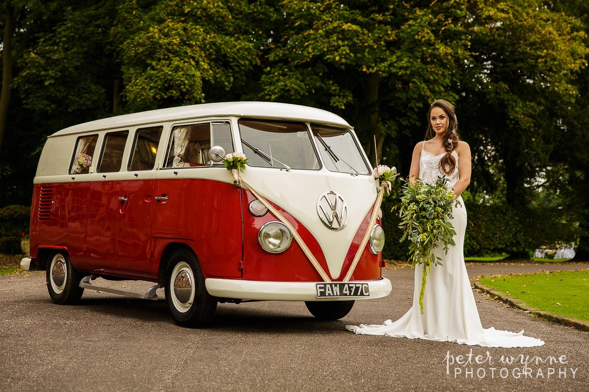 Wrenbury Hall bridal portrait next to camper van