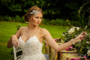 Bride sitting at outdoor table at Wrenbury Hall
