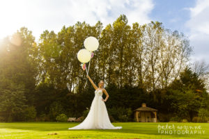 Bride with festival balloons at Wrenbury Hall