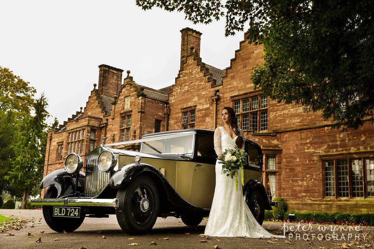 Wrenbury Hall bridal portrait with wedding car