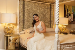 Bride posing in Wrenbury Hall bridal suite